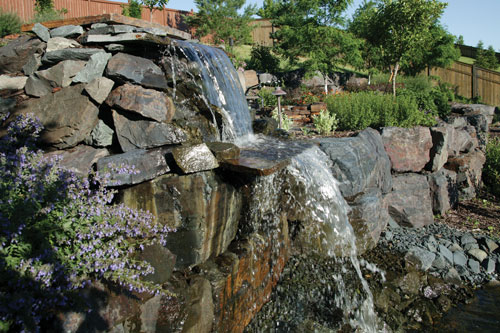 Waterfall and pond features by Meadow Green Landscaping